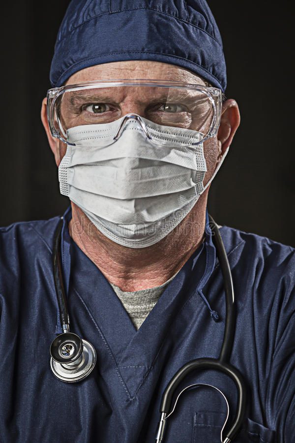 Determined Looking Doctor or Nurse with Protective Wear and Stet. Determined Looking Male Doctor or Nurse with Protective Wear and Stethoscope royalty free stock photos