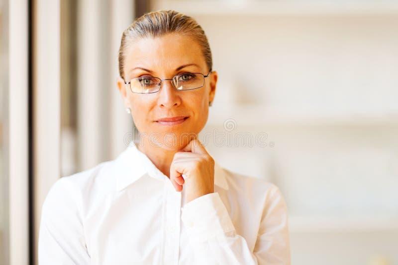 Determined senior businesswoman. Portrait in office stock images