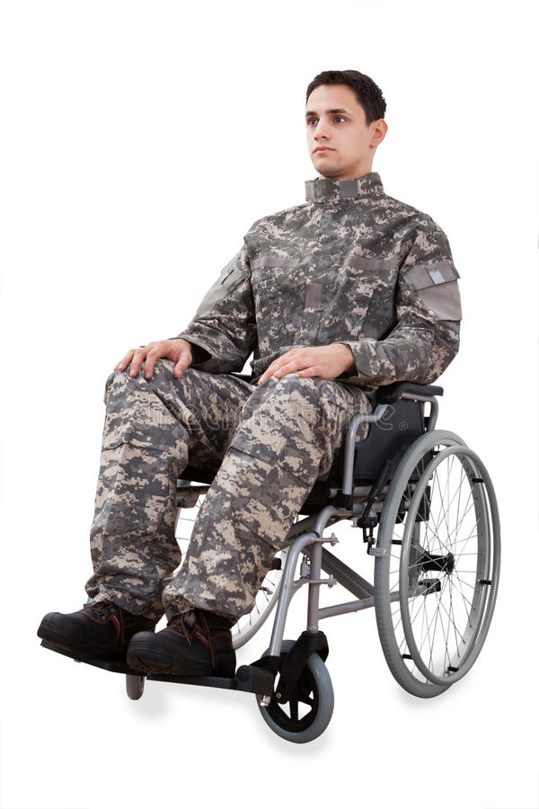 Determined soldier sitting in wheelchair. Full length of determined soldier sitting in wheelchair isolated over white background stock photos