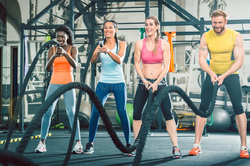 Determined and strong cheerful people during functional training royalty free stock photos