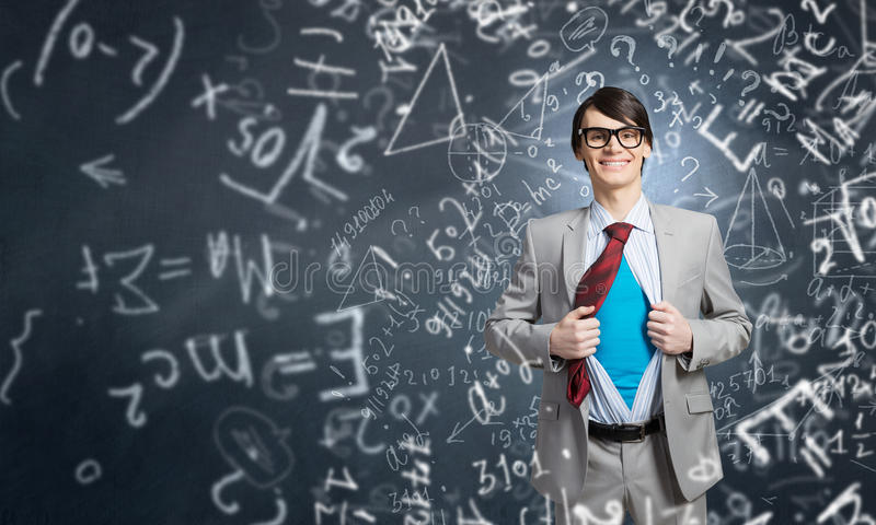 Determined super businessman. Young smiling businessman acting like super hero and tearing his shirt off stock photos