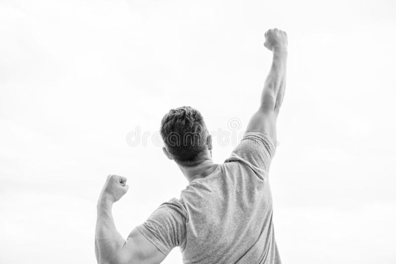 Determined to win. muscular back man isolated on white. cheerful celebrate victory. Celebrate victory or achievement royalty free stock photos