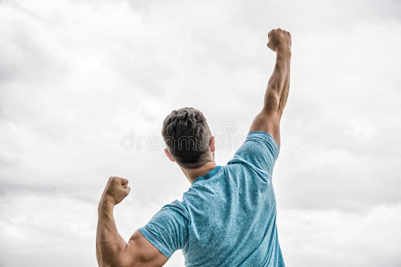 Determined to win. muscular back man  on white. cheerful celebrate victory. Celebrate victory or achievement stock image