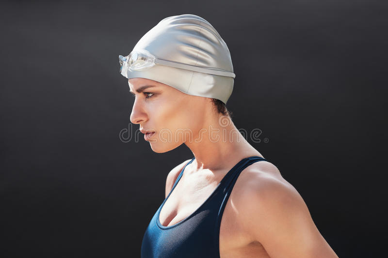 Determined young female swimmer stock image