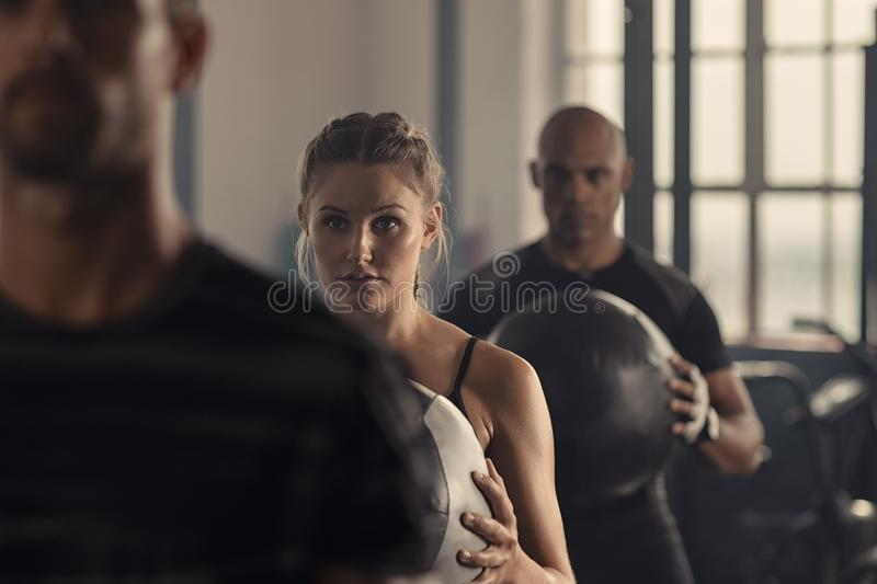 Group of fitness people exercising at gym royalty free stock photography