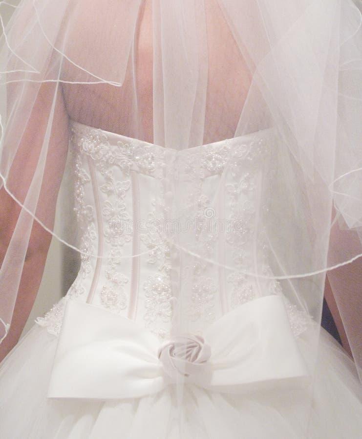 detial klänningbröllop arkivbild