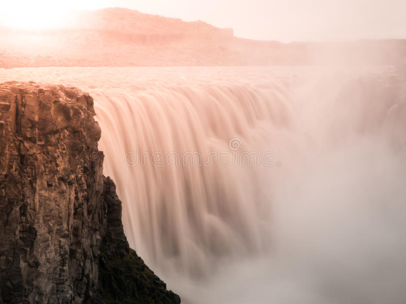 Detifoss waterfall illuminated by sunset, northern Iceland. Silk water effect by long exposure time.  stock photos