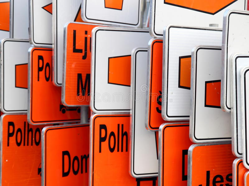 Detour orange and white traffic signs. On garage royalty free stock photos