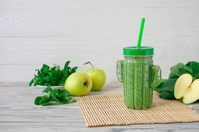 Detox fresh green smoothie with spinach, apple, mache lamb lettuce royalty free stock images
