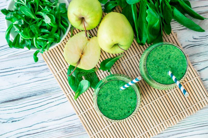 Detox fresh green smoothie with spinach, apple, mache lamb lettuce, flay lay royalty free stock images
