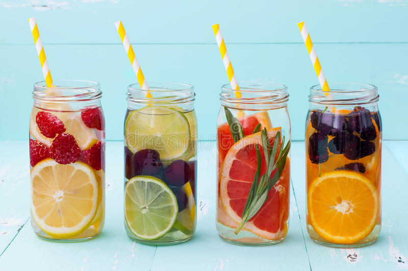 Detox fruit infused flavored water. Refreshing summer homemade cocktail. Clean eating royalty free stock photo