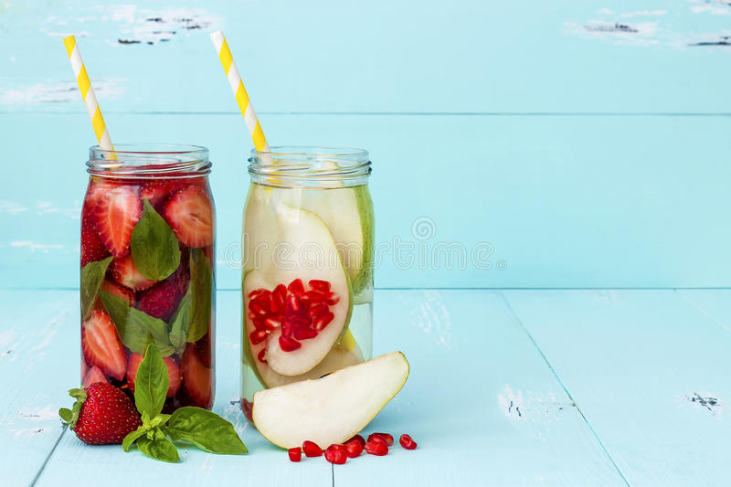 Detox fruit infused flavored water. Refreshing summer homemade cocktail. Clean eating. Copy space. Detox fruit infused flavored water. Refreshing summer stock photography