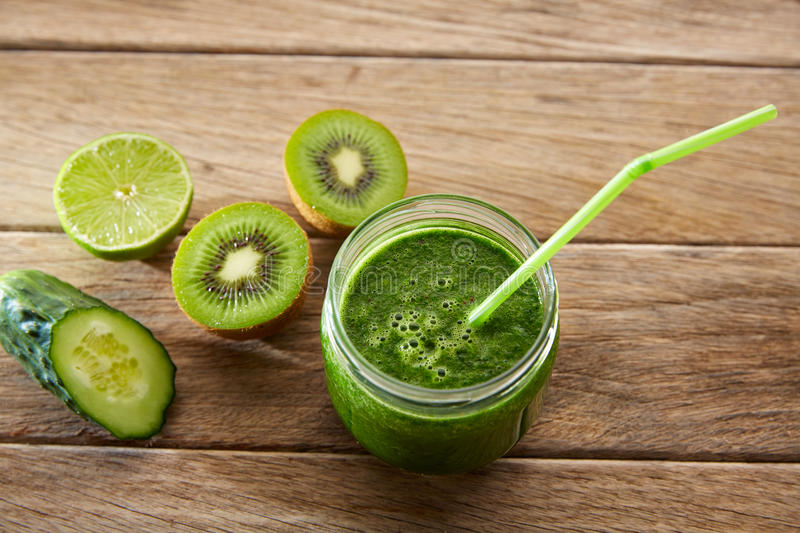 Detox green juice cleansing recipe. With also kiwi lemon cucumber spinach royalty free stock photos