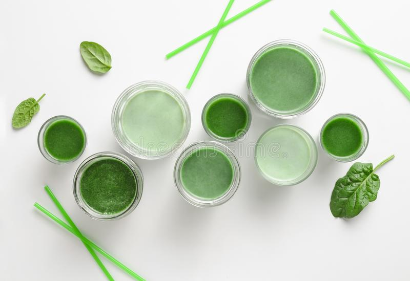 Green detox smoothies concept. Detox green smoothies concept, various glasses of green diet detox drinks, view from above royalty free stock photos