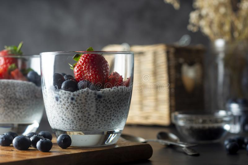 Detox and healthy breakfast chia seeds pudding with strawberries and blueberries stock photography