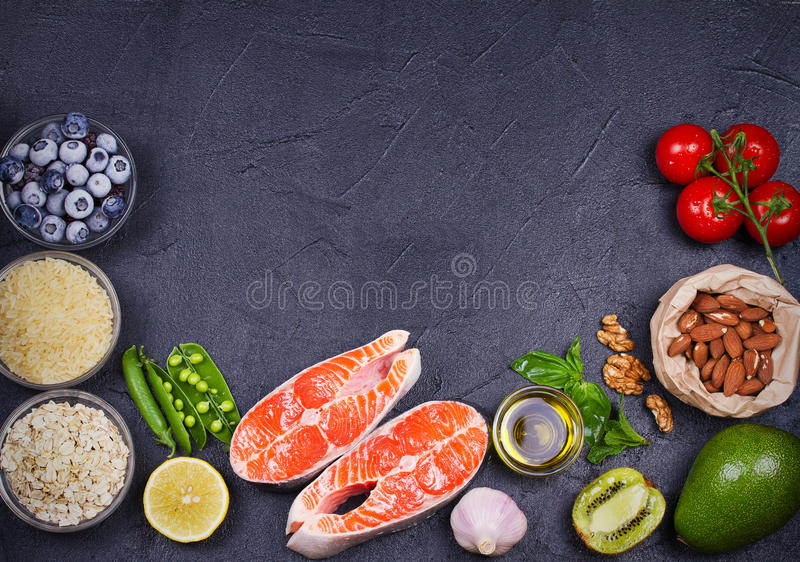 Detox healthy food concept with salmon fish, vegetables, fruits and ingredients for cooking. stock images