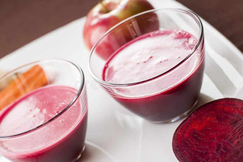 Detox juices. Beets, apples, carrots and oranges and juices for detox stock photo