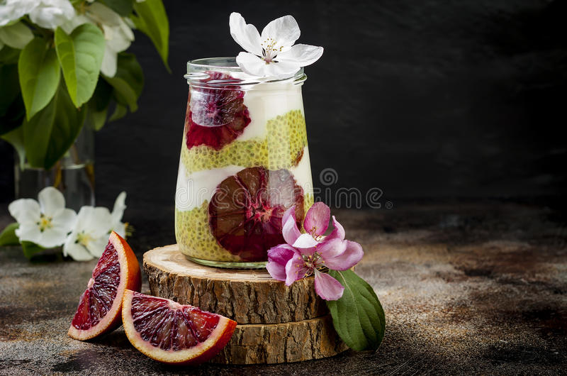Detox layered matcha green tea chia seed pudding with blood oranges. Vegan dessert with coconut whipped cream. Healthy vegetarian breakfast, dieting, weight royalty free stock photos