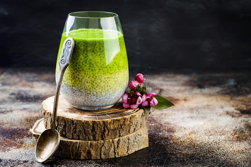 Detox ombre layered matcha green tea chia seed pudding. Vegan dessert with coconut milk. Healthy vegetarian breakfast. Dieting, weight loss food royalty free stock photography