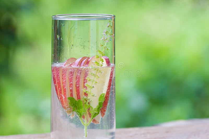 Detox water with apples on table.  royalty free stock image
