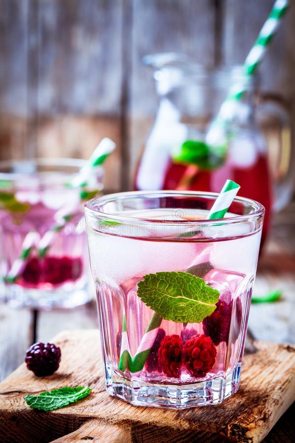 Detox water with blackberry and mint. In a glass stock photos