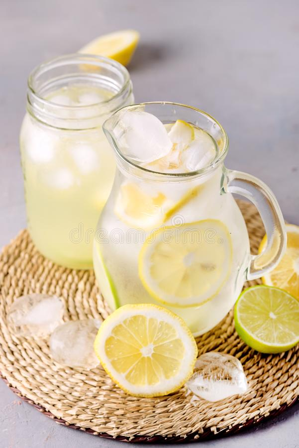 Detox Water With Lemon amd Lime and Ice Tasty Summer Lemonade Drink with Ice Cube Detox Healthy Drink Infused Water.  stock photography
