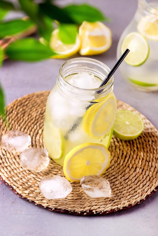 Detox Water With Lemon amd Lime and Ice Tasty Summer Lemonade Drink with Ice Cube Detox Healthy Drink Vertical. / stock image