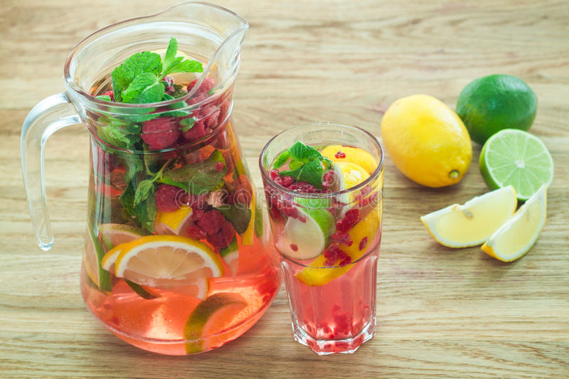 Detox water for weightloss in jug and glass closeup stock images