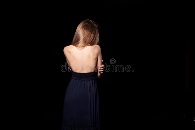 Detrás de la muchacha imagenes de archivo