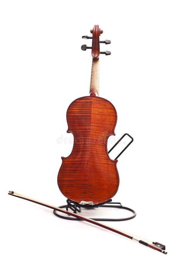 Detrás del violín y del fiddlestick fotos de archivo