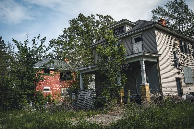 Detroit, Michigan, May 18, 2018: Abandoned and damaged single family home near downtown Detroit. Photo taken in the USA stock image