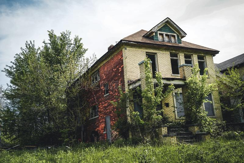 Detroit, Michigan, May 18, 2018: Abandoned and damaged single family home near downtown Detroit. Photo taken in the USA stock images