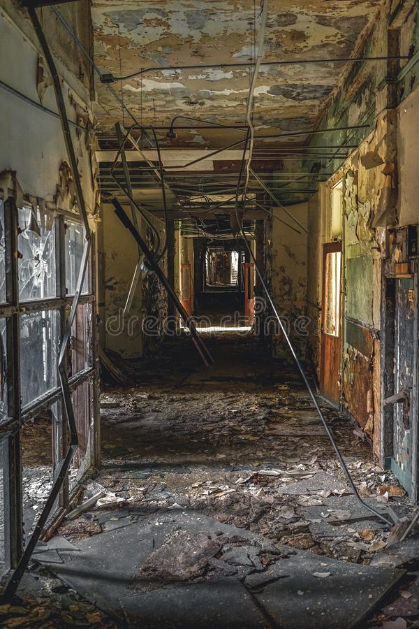 Detroit, Michigan, May 18, 2018: Interior view of abandoned and damaged George Ferris School in Detroit. Like other. Schools in Highland Park, Ferris went into royalty free stock photography