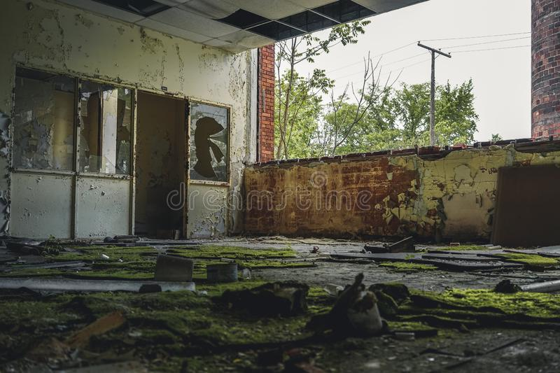 Detroit, Michigan, May 18, 2018: Interior view of abandoned and damaged George Ferris School in Detroit. Like other. Schools in Highland Park, Ferris went into royalty free stock photos
