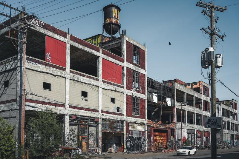 Detroit, Michigan, United States - October 2018: Outside view of the abandoned Packard Automotive Plant with water tower stock images