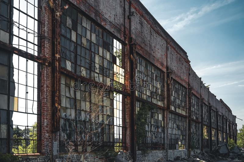 Detroit, Michigan, United States - October 18 2018: Outside view of the abandoned Packard Automotive Plant with water. Tower in Detroit. The Packard Plant stock images