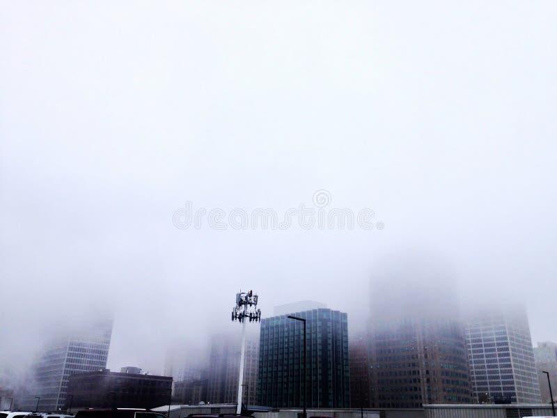 Detroit skyline blanketed in white mist stock photos
