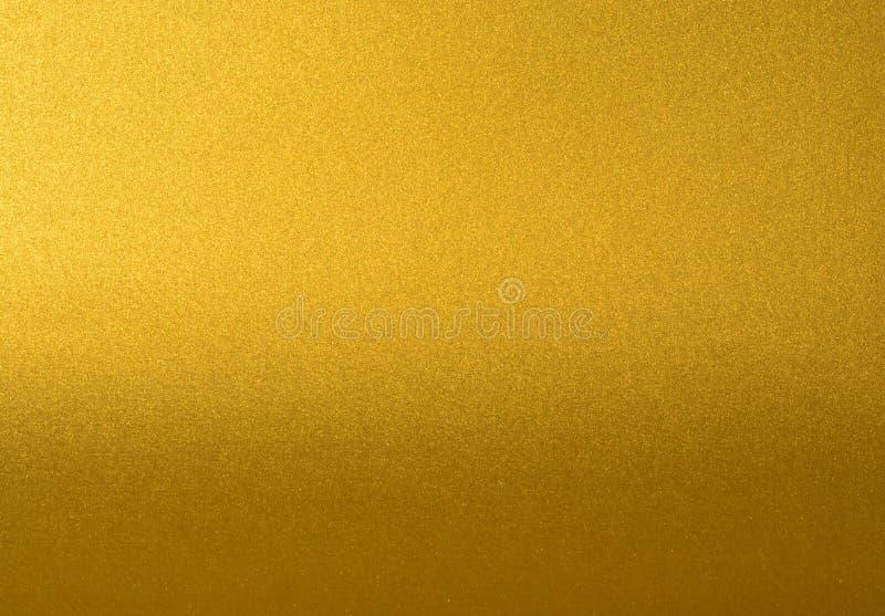 Dettagli del fondo dorato di struttura con la pendenza e l'ombra Parete della pittura di colore dell'oro Fondo dorato di lusso e immagini stock