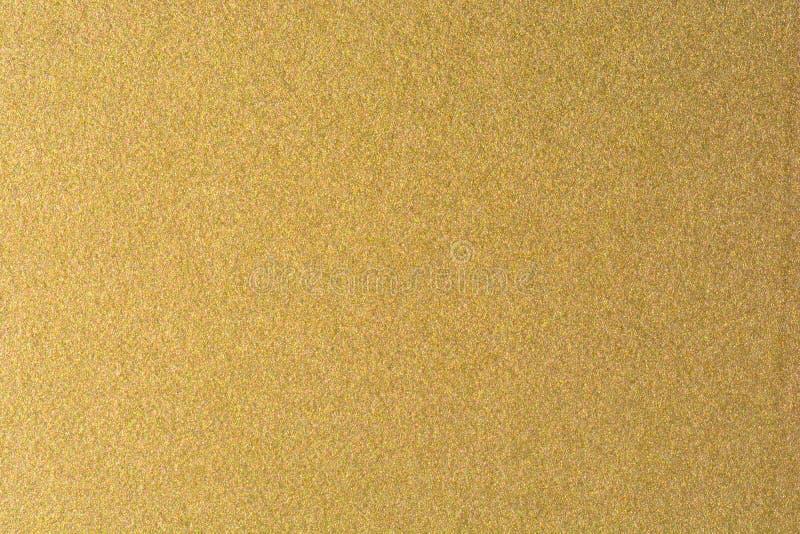 Dettagli del fondo dorato di struttura Parete della pittura di colore dell'oro Fondo e carta da parati dorati di lusso Stagnola d immagini stock