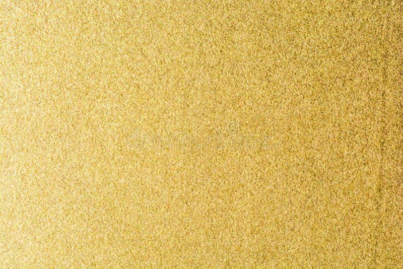 Dettagli del fondo dorato di struttura Parete della pittura di colore dell'oro Fondo e carta da parati dorati di lusso Stagnola d immagini stock libere da diritti