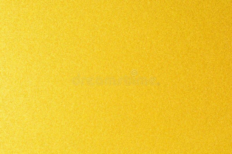 Dettagli del fondo dorato di struttura Parete della pittura di colore dell'oro Fondo e carta da parati dorati di lusso Stagnola d fotografia stock