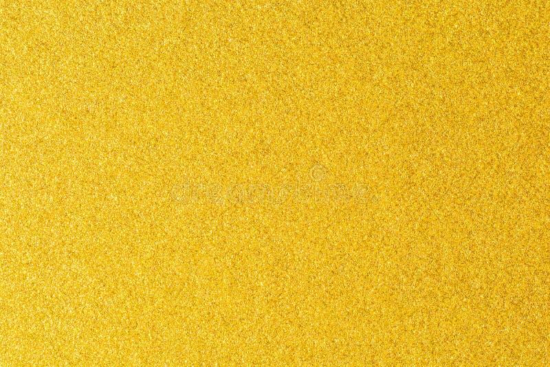 Dettagli del fondo dorato di struttura Parete della pittura di colore dell'oro Fondo e carta da parati dorati di lusso Stagnola d immagine stock libera da diritti