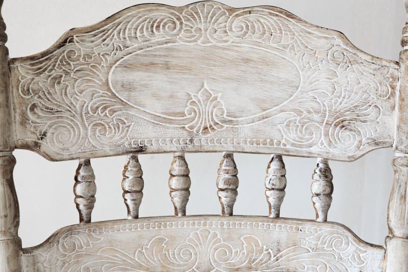 Dettagli della sedia scolpita antica fotografia stock