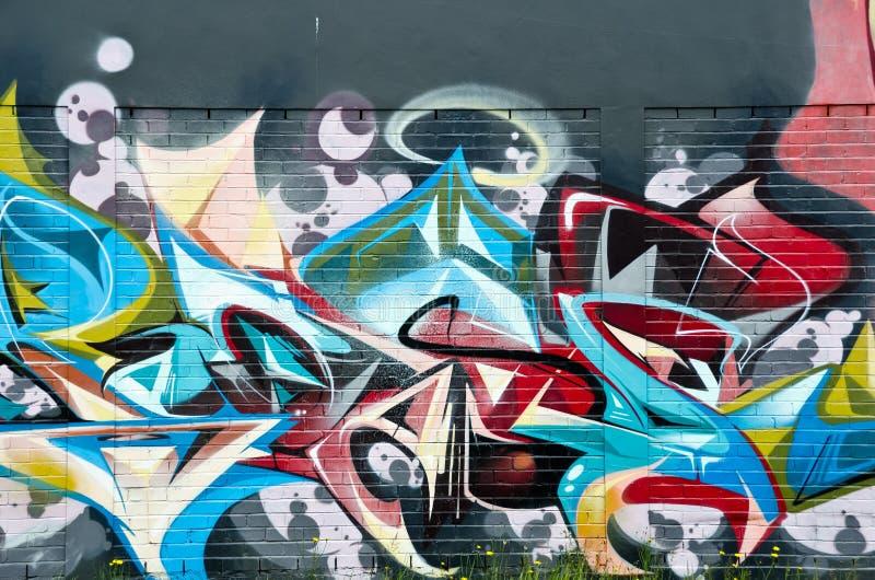 Dettaglio astratto dei graffiti sul muro di mattoni fotografia stock