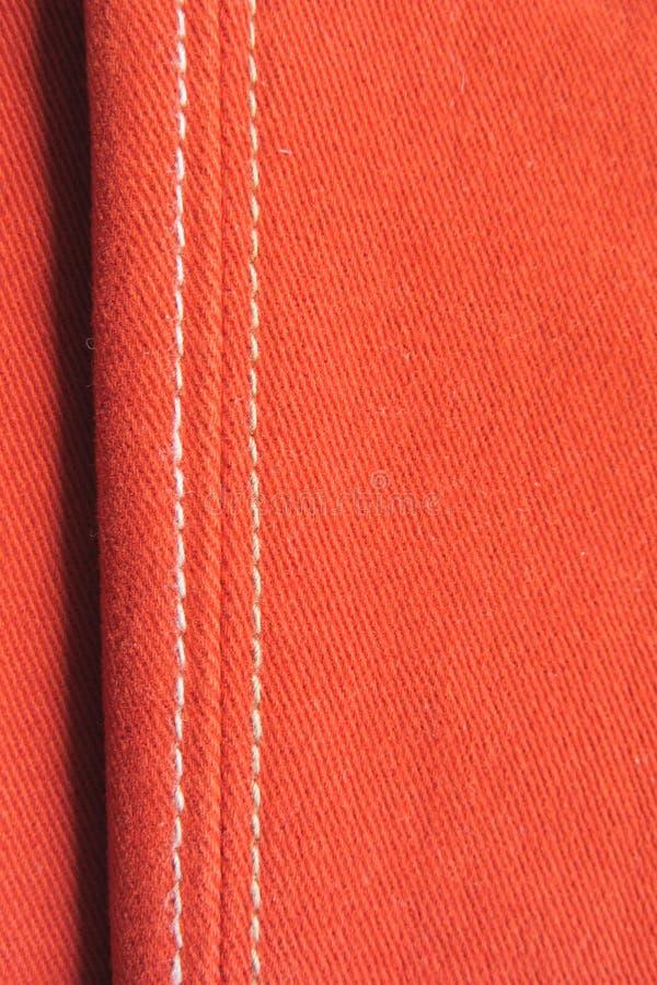 Dettaglio dall'jeans rossi utilizzati immagine stock