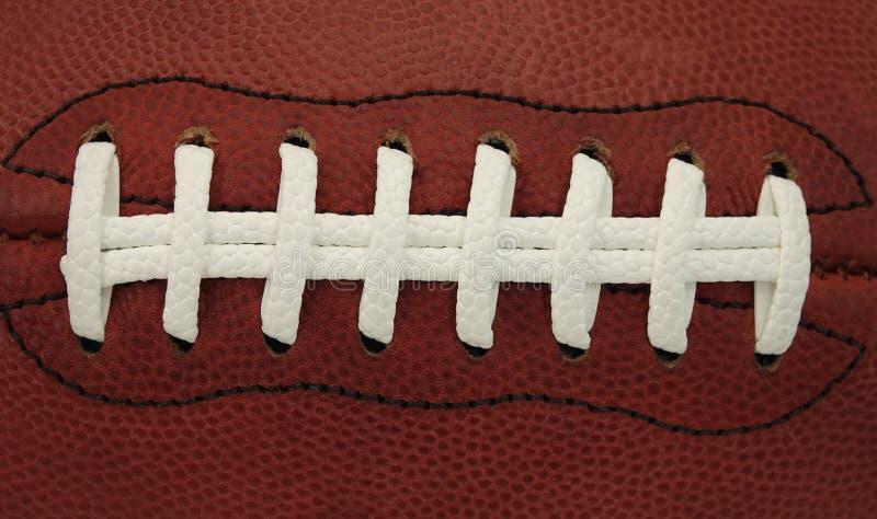 Dettaglio dei pizzi su una palla del gioco di football americano fotografie stock libere da diritti