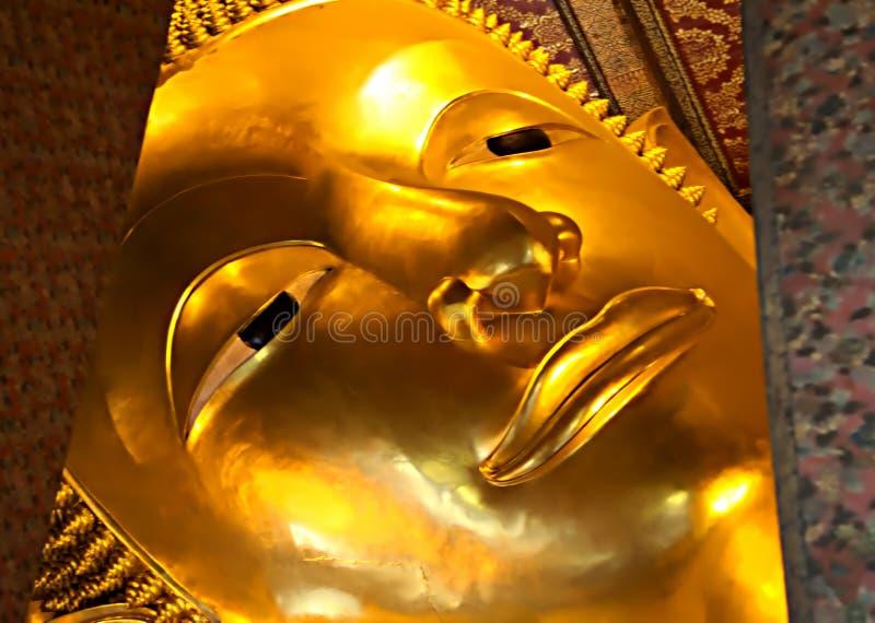 Dettaglio del Buddha adagiantesi al tempio di Wat Pho, Bangkok immagine stock libera da diritti