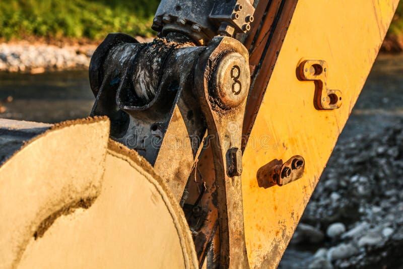 Dettaglio del meccanismo unito del secchio scavatore della macchina dell'escavatore Immagine astratta per illustrare costruzione immagini stock libere da diritti