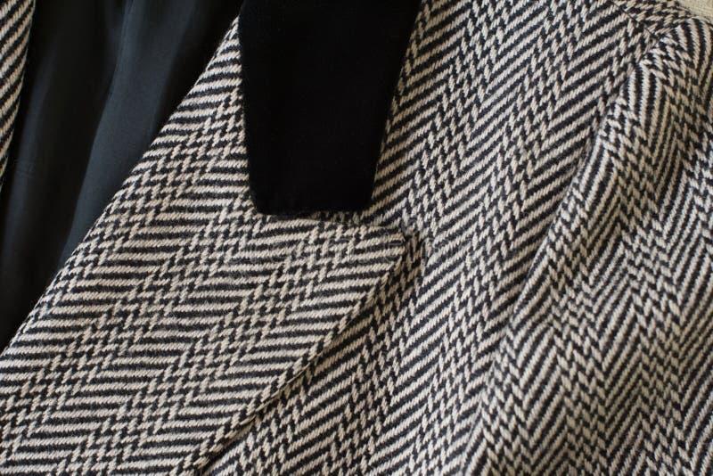 Dettaglio del tessuto di saia tagliato spina di pesce di lana del rivestimento fotografia stock