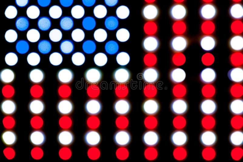 Dettaglio delle luci principali vaghe che formano una bandiera americana d'ardore luminosa illustrazione di stock